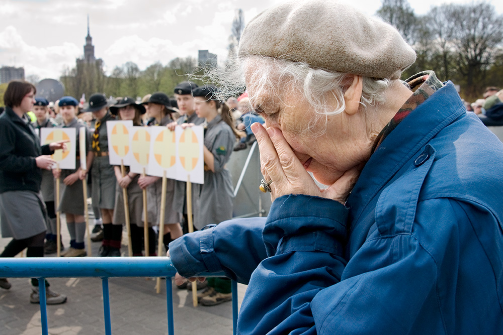 An old woman during the ceremony in a memory of crash victims. The Catholic mass.
