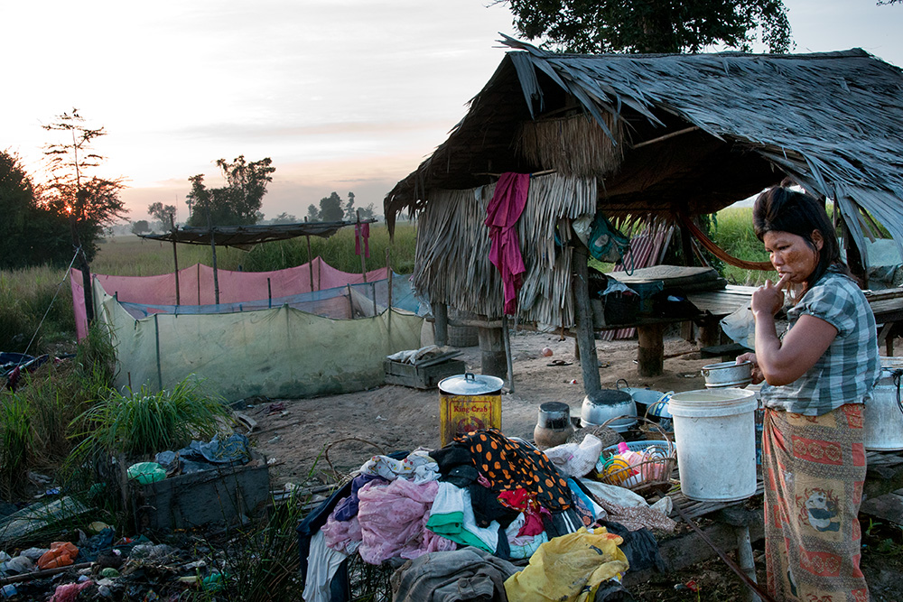 Poor settlements on a garbage dump in Siem Reap, early morning. People wake up and start another busy day on a dump.