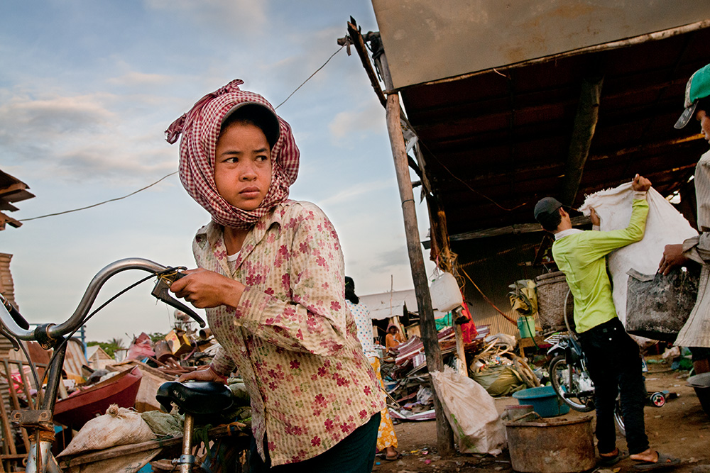 A girl leaves a warehouse after selling of some of recyclable waste.